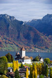 Spiez castle in Switzerland. Scenic view if Spiez castle with lake Thun in background, Bern, Switzerland Royalty Free Stock Images
