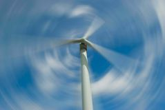 Spiining wind turbine stock image