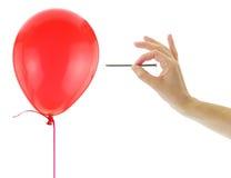 Spijker ongeveer om een ballon te knallen Royalty-vrije Stock Foto