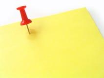 Spijker op geel document stock afbeelding
