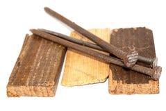 Spijkers en hout Stock Foto's