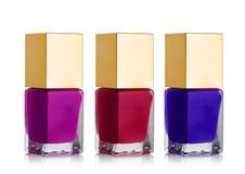 Spika kosmetiska flaskor för polermedel med den guld- överkanten Royaltyfri Fotografi