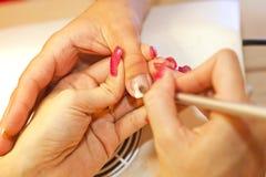 Spika manicuren royaltyfria foton