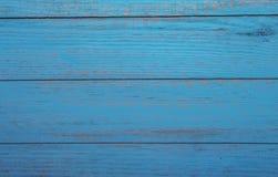 Spikar blå wood bakgrundstextur för tappning med fnuren och hål gammalt målat trä abstrakt bakgrundsblue Arkivfoton