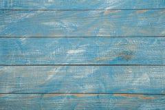 Spikar blå wood bakgrundstextur för tappning med fnuren och hål gammalt målat trä abstrakt bakgrundsblue Arkivbild
