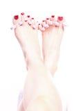 spikar foten kvinnlig polerad red Arkivbild
