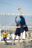Spike. Man jumping attack. Beach volleyball. April 12, 2015. Beach Volleyball Tournament men. Location: Ostia (Hibiscus), Rome. Italy. A beach player is going to Stock Photos