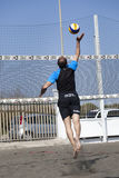 Spike. Man jumping attack. Beach volleyball Royalty Free Stock Image