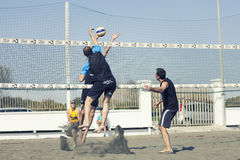 Spike. Man jumping attack. Beach volleyball. April 12, 2015. Beach Volleyball Tournament men. Location: Ostia (Hibiscus), Rome. Italy. A beach player is going to Royalty Free Stock Images