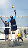 Spike. Man jumping attack. Beach volleyball Royalty Free Stock Photos
