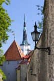 Spike of St Olaf (Oleviste) Church and fortification tower. Tallinn, Estonia Royalty Free Stock Images