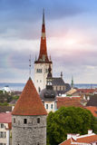 Spike of St Olaf Oleviste Church and fortification tower. Tallinn, Estonia.  Royalty Free Stock Photography