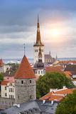 Spike of St Olaf Oleviste Church and fortification tower. Tallinn, Estonia Royalty Free Stock Images