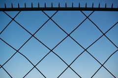 Spiked metal fence Royalty Free Stock Photos