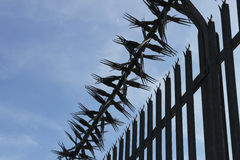 Spiked Metal Fence Stock Images