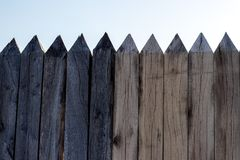 Spiked wooden fence royalty free stock photo