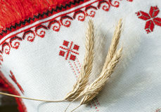 Spikelets of wheat on the embroidered towel Stock Images