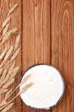 Spikelets of wheat and flour a wooden board. Royalty Free Stock Images