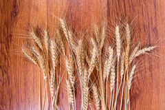 Spikelets of wheat on the wooden background. Stock Photo