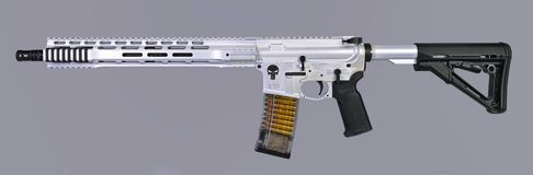 Spikes Tactical Punisher AR15 rifle finished in white pearl with black chrome accents. Spikes Tactical AR15 lower completed rifle painted pearl white upper royalty free stock photos