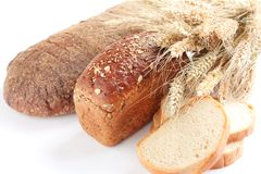 Spikes of wheat and  bread. Spikes of wheat and different kinds of bread Royalty Free Stock Photos