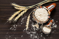 Spikes of wheat and whole-wheat flour Stock Photos