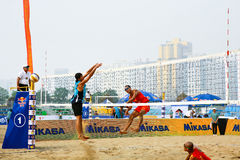 Spiking in beach volleyball game Royalty Free Stock Photos