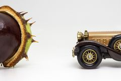 Two collectibles: conker and toy car stock photography