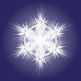 Spiky white snowflake on dark background Royalty Free Stock Photo