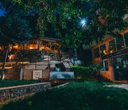 Spili Crete, Greece August 2018: Night view on a park in the village of Spili with tavernas on Crete island. Photo taken in Greece stock photography