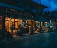 Spili Crete, Greece August 2018: Night view on a street in the village of Spili with souvenier shops and tavernas on. Crete island.. Photo taken in Greece stock image