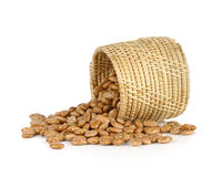 Spill the beans - pinto beans spilled from basket isolated on wh. Ite background Royalty Free Stock Photography