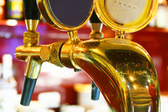 Spill my beer. A tap for spilling beer in a glittering bar royalty free stock photography