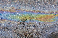 Spill of oil spilled on asphalt. Royalty Free Stock Images