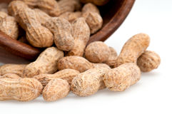 Spill of peanuts. Close up view of peanuts spill from bowl, macro shot, use of selective focus Royalty Free Stock Photo