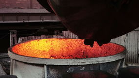 Spill steel. Thick metal bridge through channel current molten iron stock footage