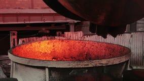 Spill steel. Thick metal bridge through channel current molten iron stock video