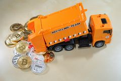 Spill waste cryptocurrency from dumpster car. Conceptul image to cryptocurrency bubble Stock Photos