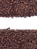 Spillda kaffebönor Arkivfoto