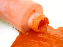 Spilled #2. Orange spilled paint stock image
