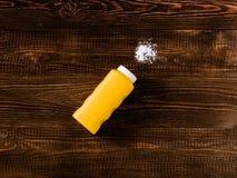 Spilled baby talcum powder on dark wooden background Stock Photo