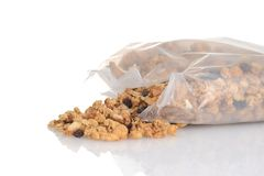 Spilled bag of granola raisin almond cereal. Closeup spilled bag of granola raisin almond cereal royalty free stock images