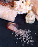 Spilled Beads and a laughing buddha. Stock Photos