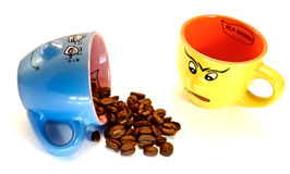 Spilled the beans. Coffee cup spilled coffee beans while other disappointedly witness the fact Royalty Free Stock Photos