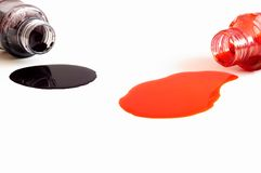 Spilled a bottle of black and red ink. On white background Royalty Free Stock Photo