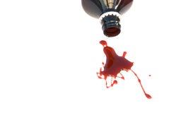 Spilled bottle of liquid Stock Image