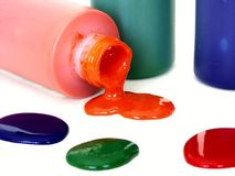 Spilled Bottle of Paint. Paint bottles with spots of paint Royalty Free Stock Photography