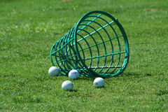 Spilled bucket of practice golf balls Stock Images