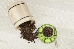 Spilled coffee beans, coffee mug Stock Photos