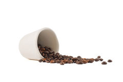 Spilled coffee beans from the cup  Royalty Free Stock Photography